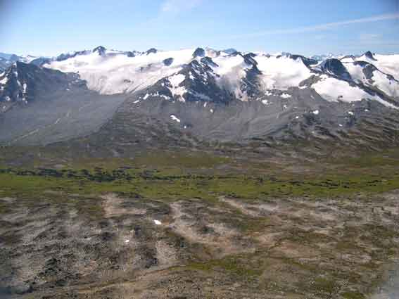 Looking S from 'Peak 8269' over 'Slim Pass' to Socerer (on left) with its receding glacier