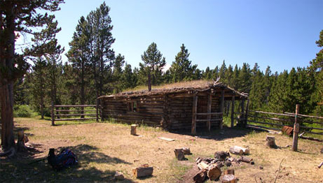 The historic Graveyard cabin with its sod roof still stands today