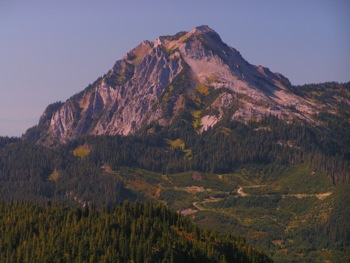 The limestone dominated Mt. McGuire showing the karst topography of its W slopes (L). Spencer Peak rests below