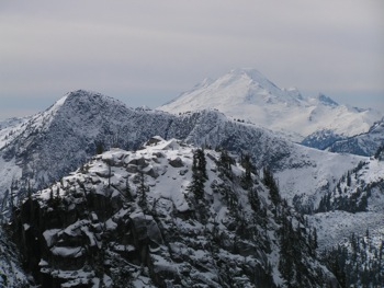 View from Mt. Rexford Trail across Slesse-Nesakwatch divide and the USA border to Mt. Baker