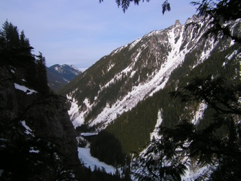 Frozen Lindeman Lake with 'Gargoyles' above from Goat Mountain Trail viewpoint