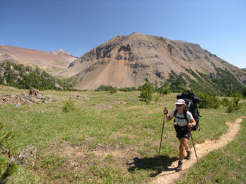 Backpacking along the Deer Pass Trail with 'Sheba Ridge' in the distance