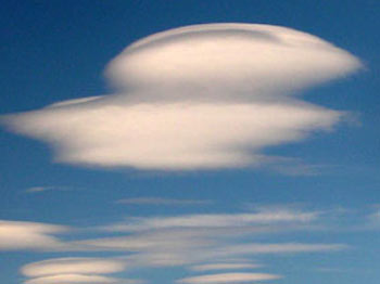Lenticular clouds, common to the South Chilcotin Mountains, often foretell a change in the weather
